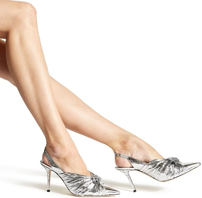 Made from crinkled coated leather, the point-toe silhouette is set on a slim stiletto heel and features a knotted vamp