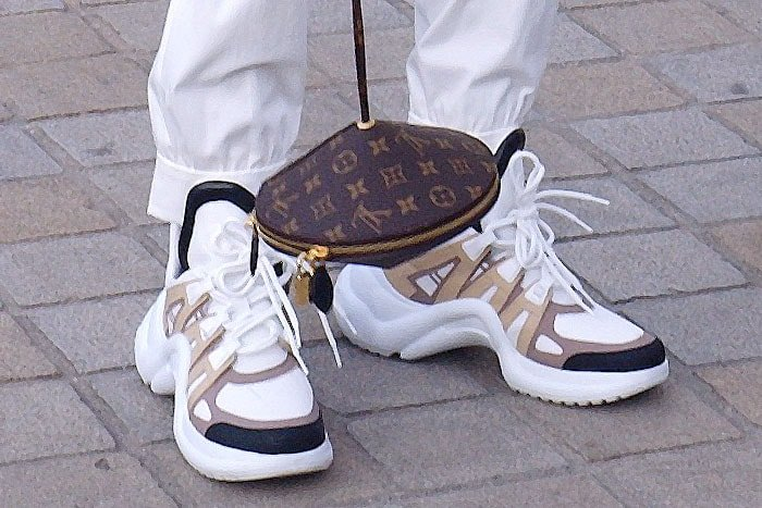 Details of Jaden Smith's Louis Vuitton 'Toupie' bag and dad sneakers, the Louis Vuitton 'Archlight' from the women's line