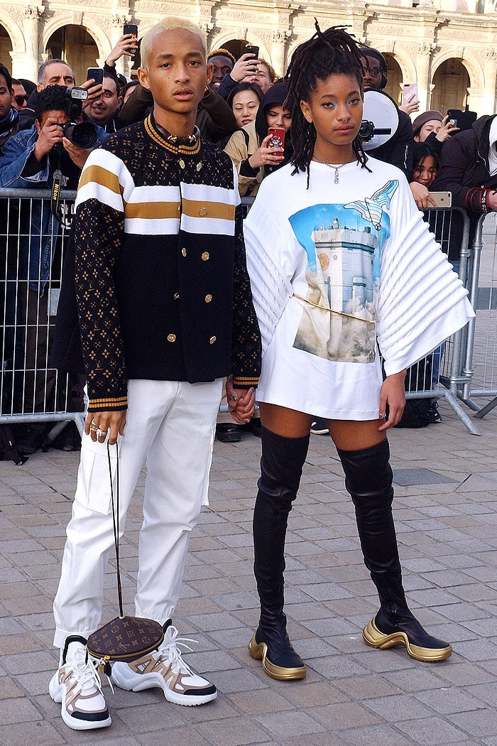 Jaden Smith and Willow Smith holding hands as they arrive for the Louis Vuitton Fall 2019 show