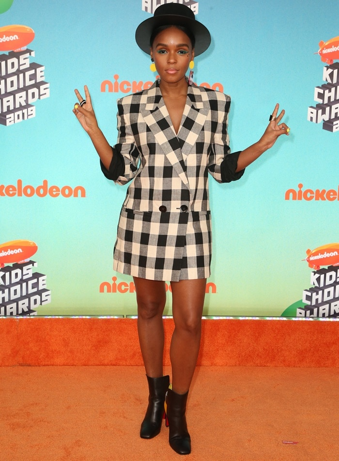Janelle Monae paraded her legs in a black-and-white checked tuxedo jacket from the Petar Petrov Spring '19 Runway collection