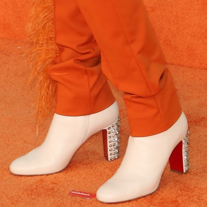 Jennifer Hudson's snow white Suzi Folk leather red sole booties by Christian Louboutin