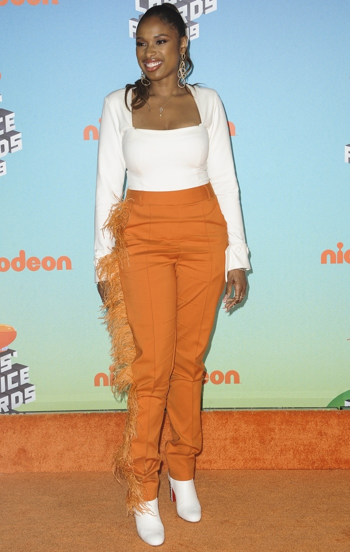 Jennifer Hudson wearing orange feather-pants on the orange carpet at the 2019 Nickelodeon Kids' Choice Awards held at the Galen Center in Los Angeles on March 23, 2019