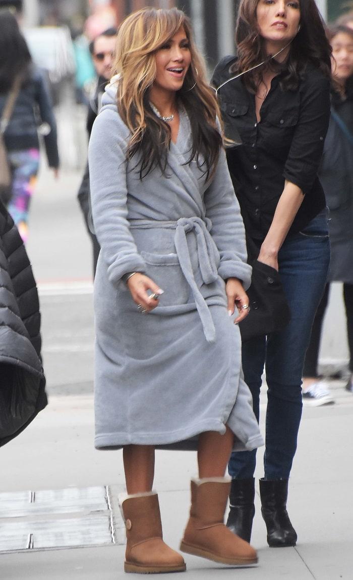 Jennifer Lopez wears a bathrobe robe on the 'Hustlers' film set in New York City on March 28, 2019