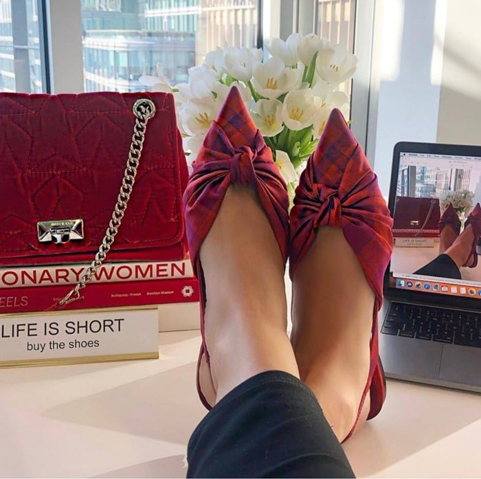Jimmy Choo's Annabell pumps in check print and the Helia bag in raspberry velvet