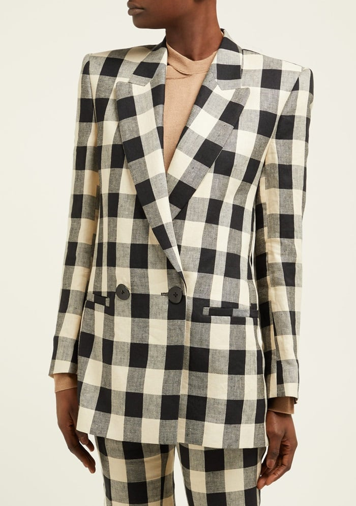 This blazer is rendered in a black and ivory check that gives a graphic dimension to the Vienna-based Petar Petrov's signature power-suit influenced silhouette