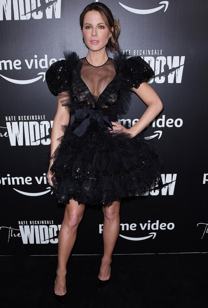 Kate Beckinsale paraded her toned legs on the black carpet