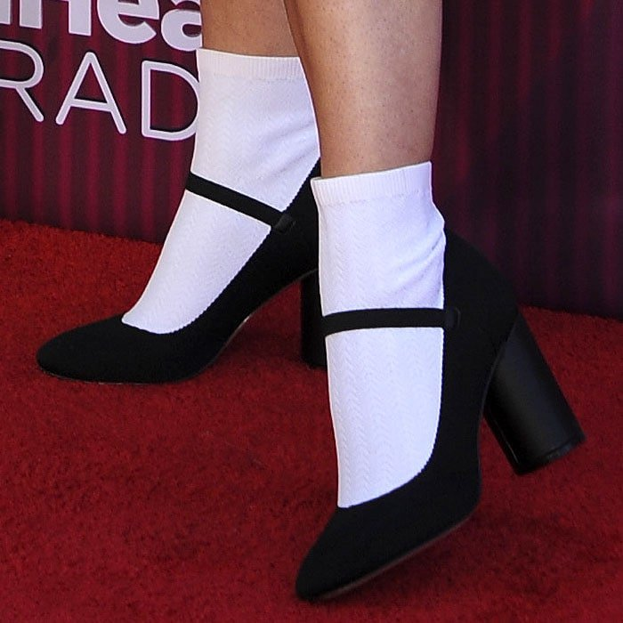 Closeup of the Katy Perry 'Isobella' stretch-knit booties made to look like white socks with black mary janes