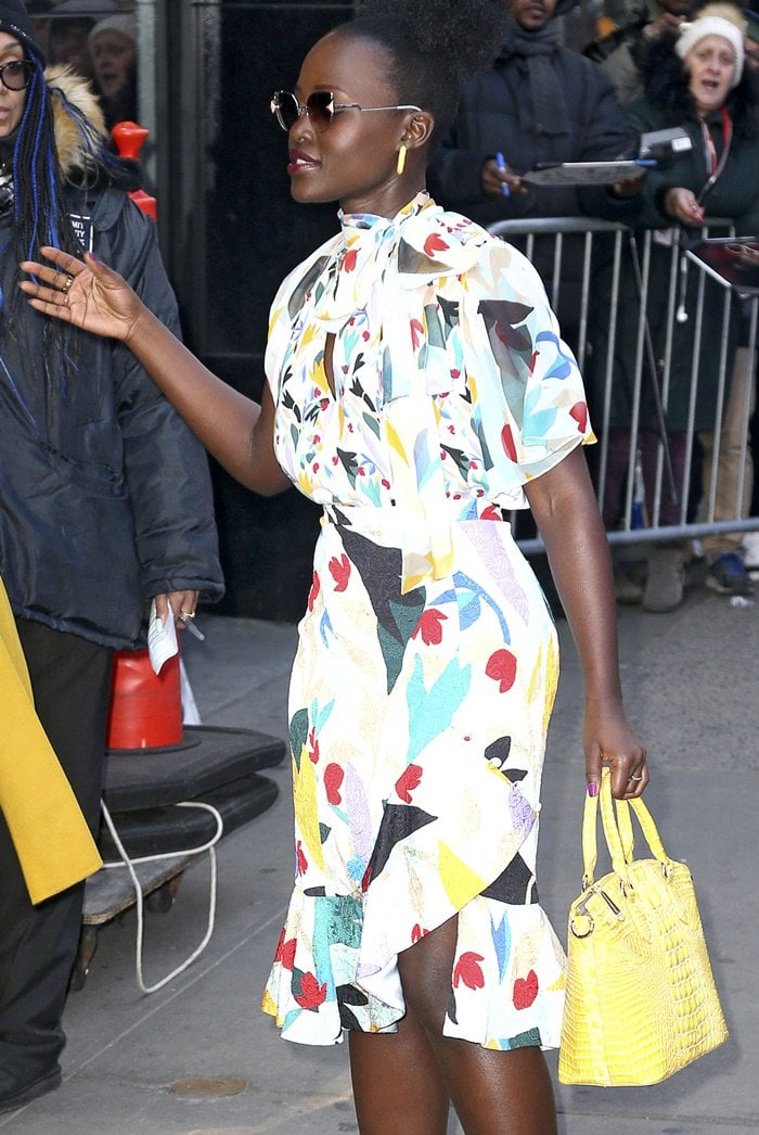 Lupita Nyong'o floral-print keyhole blouse and skirt outside of the Good Morning America studios ahead of her appearance in New York City on March 19, 2019