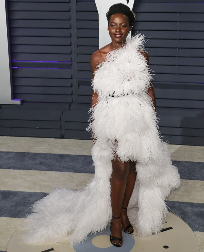 Lupita Nyong'o in a white feathered Oscar de la Renta Fall 2019 dress at the 2019 Vanity Fair Oscar Party at the Wallis Annenberg Center for the Performing Arts in Beverly Hills, California, on February 24, 2019