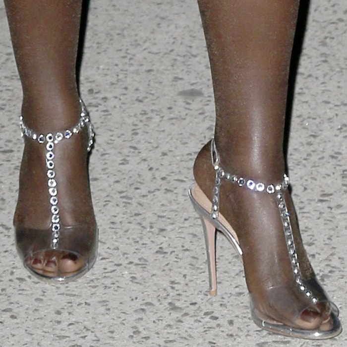 Lupita Nyong'o hot toes in transparent PVC sandals with jeweled studs