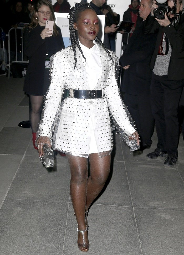 Lupita Nyong'o flaunted her legs in a studded PVC blazer from Balmain