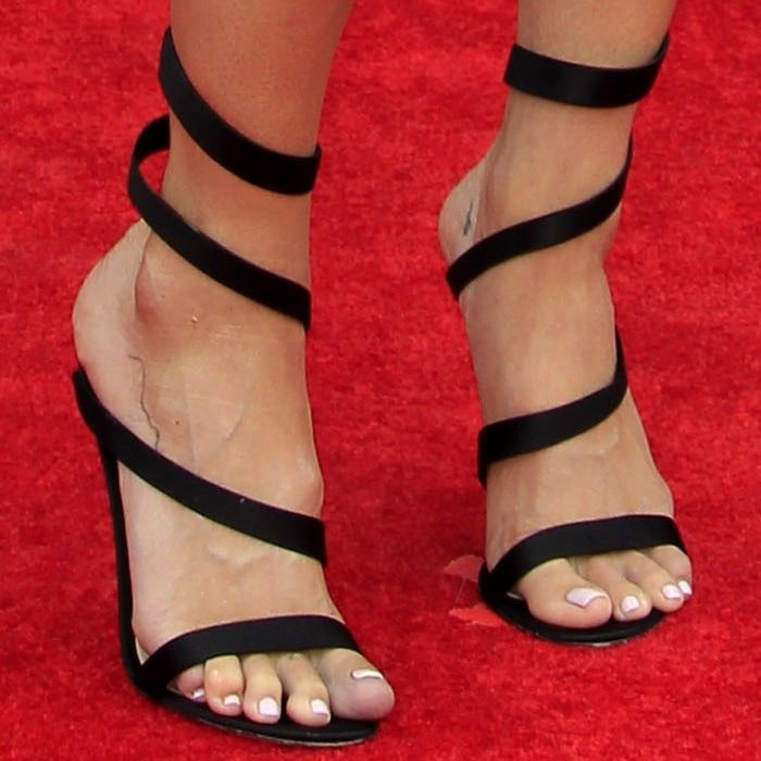 Mandy Moore's monster feet in black strappy sandals