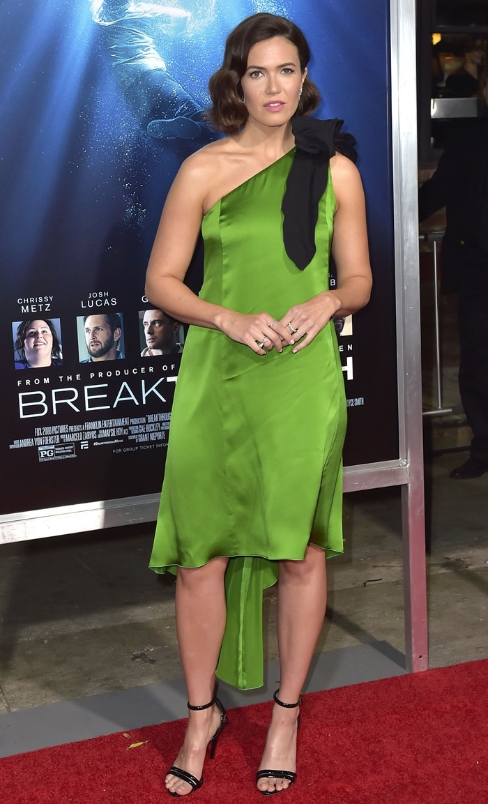 Mandy Moore's hot legs in a kelly-green one-shoulder dress at the premiere of Breakthrough held at the Westwood Regency Theater in Los Angeles on April 11, 2019