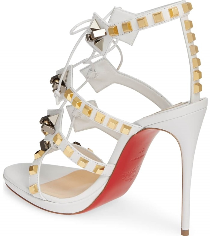 With their retro-inspired architectural look, the Multiplaticool open-toe sandal is enamored with multi-straps featuring gold spikes intertwined with rope