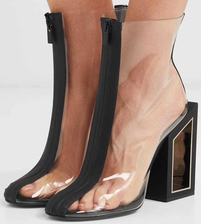 Made from leather, these boots have a square block heel, a front zip fastening and a transparent construction