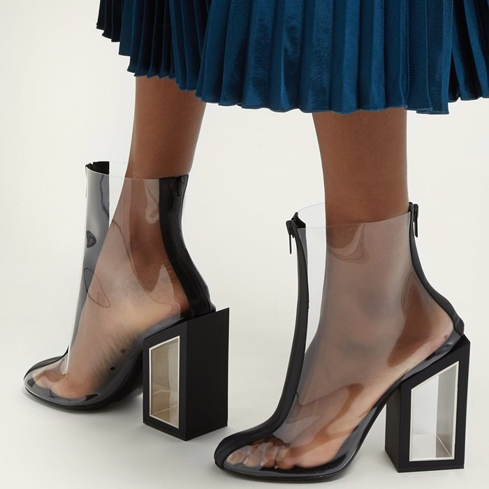 On-trend clear PVC ankle boots featuring a bold cutout block heel for an eye-catching look