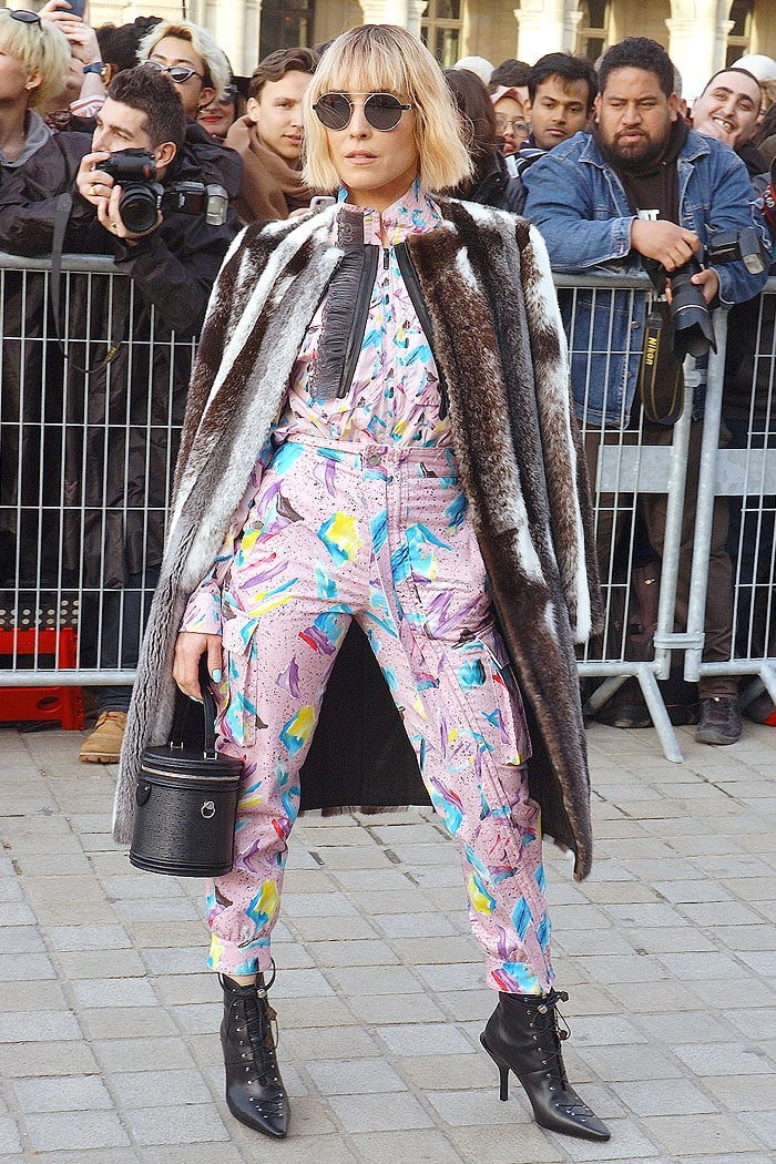 Noomi Rapace going heavy on the '80s aesthetic and a fur coat at the Louis Vuitton Fall 2019 fashion show
