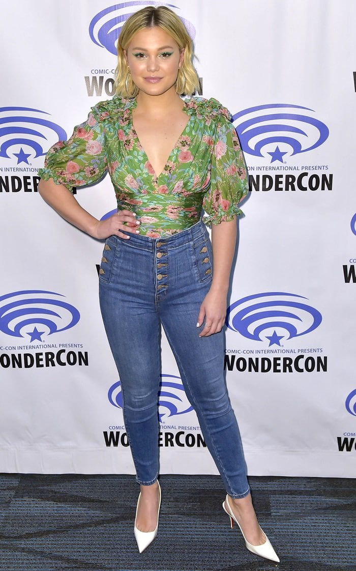 Olivia Holt wearing J Brand's highest rise jeans with buttons at the fly and on both sides at the hip