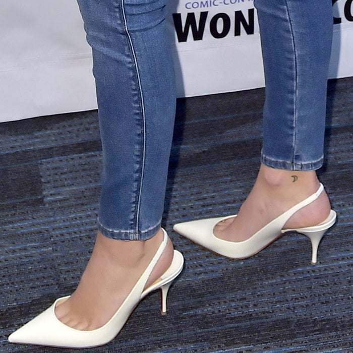 Olivia Holt's crescent moon tattooed on the inside of her right ankle