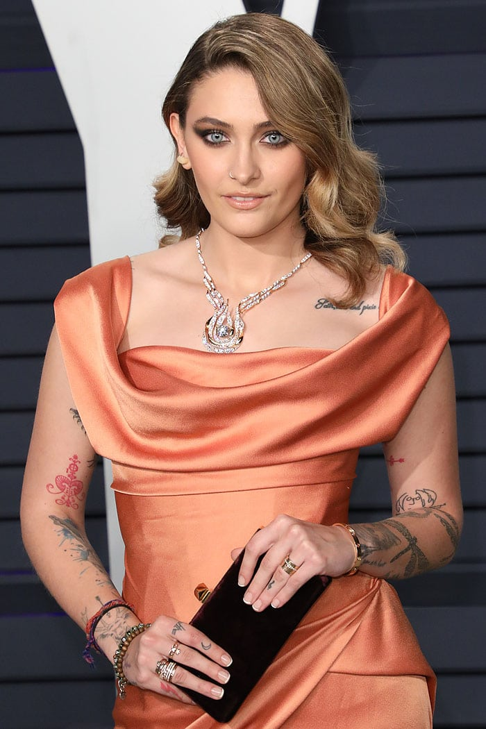 Paris Jackson wearing a stunning Hearts On Fire necklace, Le Vian rings, and carrying a Jimmy Choo 'Celeste' velvet clutch