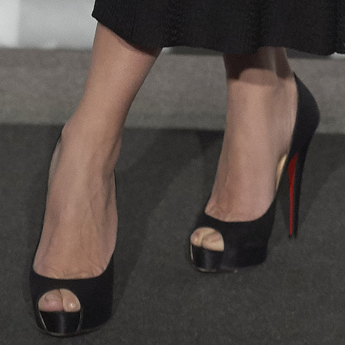 Closeup of Penelope Cruz's Christian Louboutin 'Very Prive' black-satin peep-toe pumps