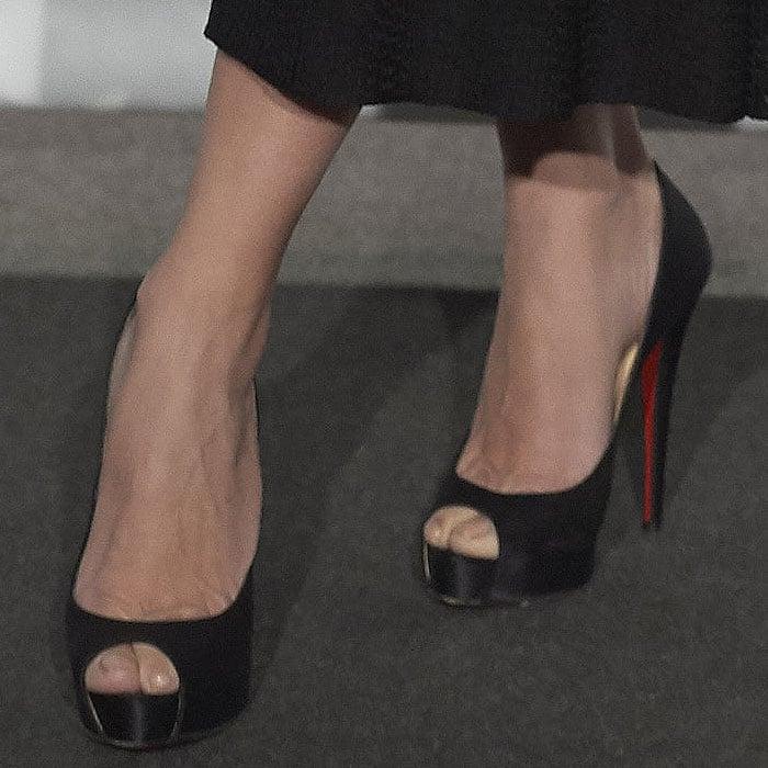 Closeup of Penelope Cruz's Christian Louboutin 'Very Prive' black-satin peep-toe pumps