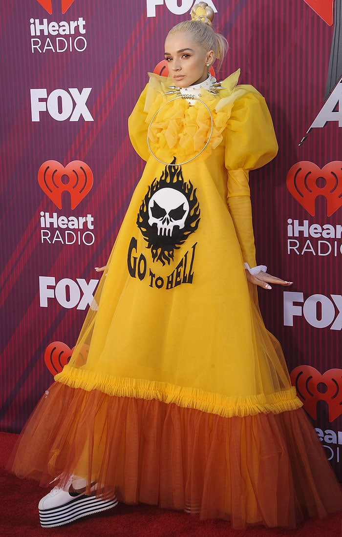 """Poppy wearing Viktor & Rolf Spring 2019 Haute Couture """"Go To Hell"""" dress and at the Comme des Garçons x Nike Cortez platform sneakers"""
