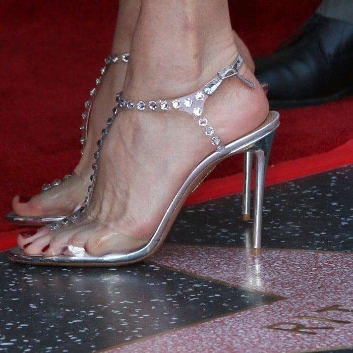 Rita Wilson's hot feet in Aquazzura Shine crystal-embellished PVC sandals