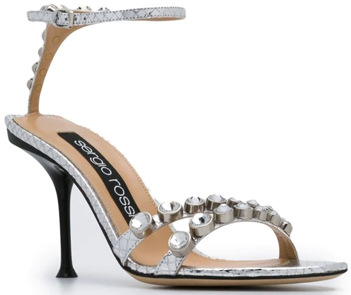 These silver-tone leather crystal embellished sandals feature an open toe, crystal embellishments, a branded insole, an ankle strap with a side buckle fastening, a high heel and a leather sole