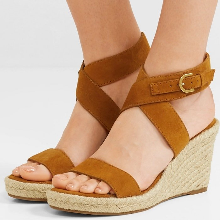 Made in Spain from velvety suede, this pair has flattering crossed straps and rubber sole for added traction