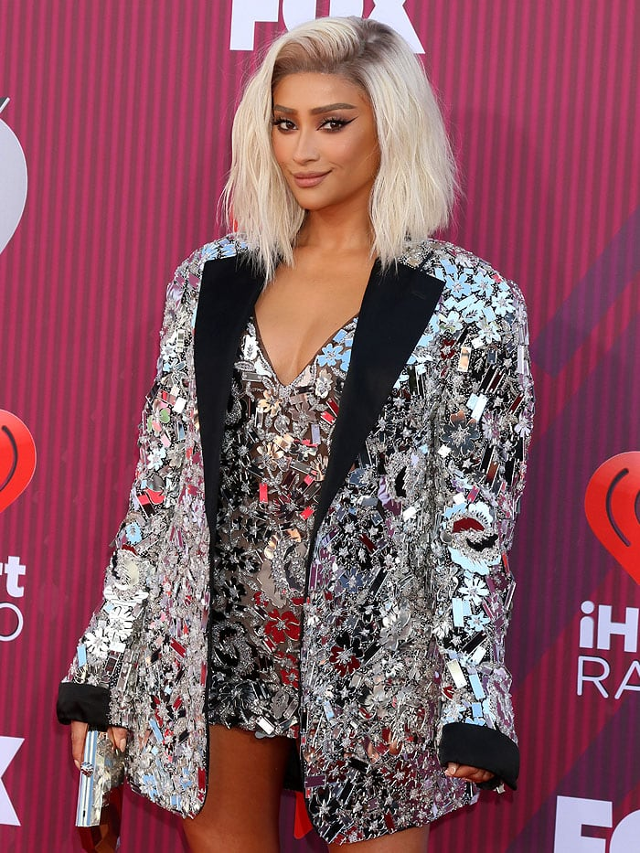 Shay Mitchell wearing a blonde lace-front wig to cover her signature black tresses