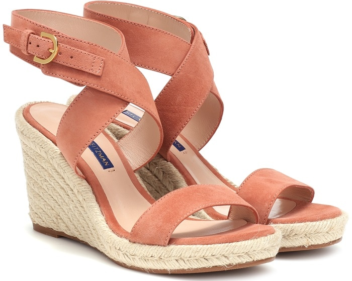 his wedge style has been crafted in Spain with a supple suede upper, including straps that wrap the ankle for a foot-framing finish, and comes set on a braided jute sole for a classic warm-weather look