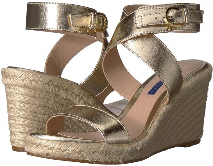 A classic sandal to elevate your sun-chasing style is crafted with a gracefully crisscrossed ankle strap and a jute-wrapped wedge sole.