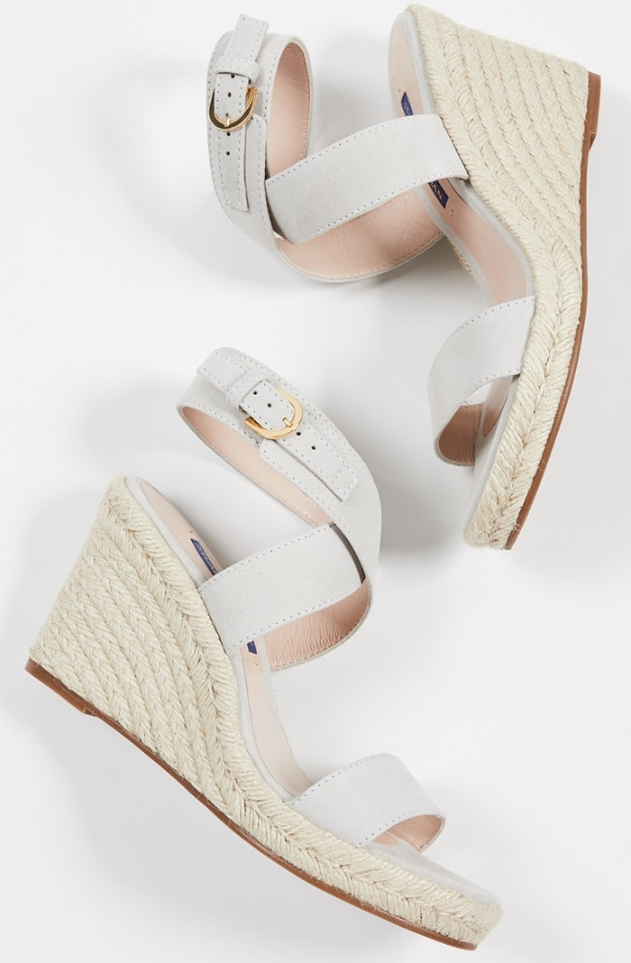 Wide wraparound ankle straps in suede or nappa lend a modern touch