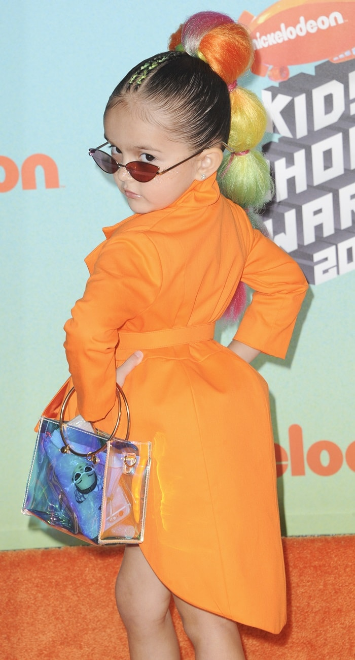 Taylen Biggs posing in an orange blazer from luxury children clothing brand Kadime