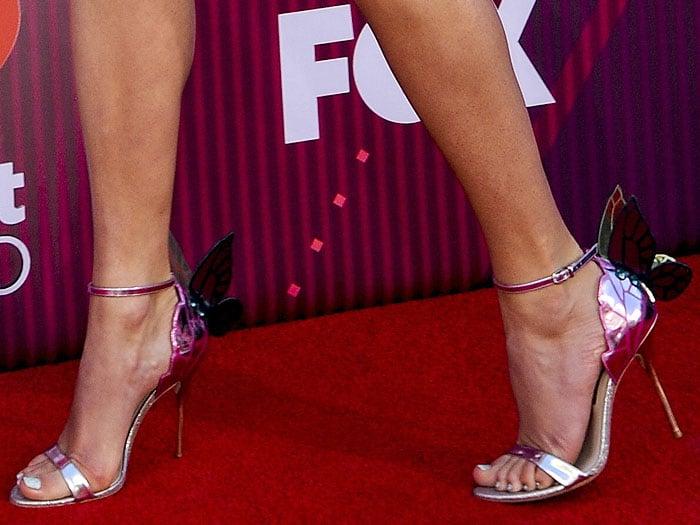 Closeup of the Sophia Webster 'Chiara' sandal on Taylor Swift