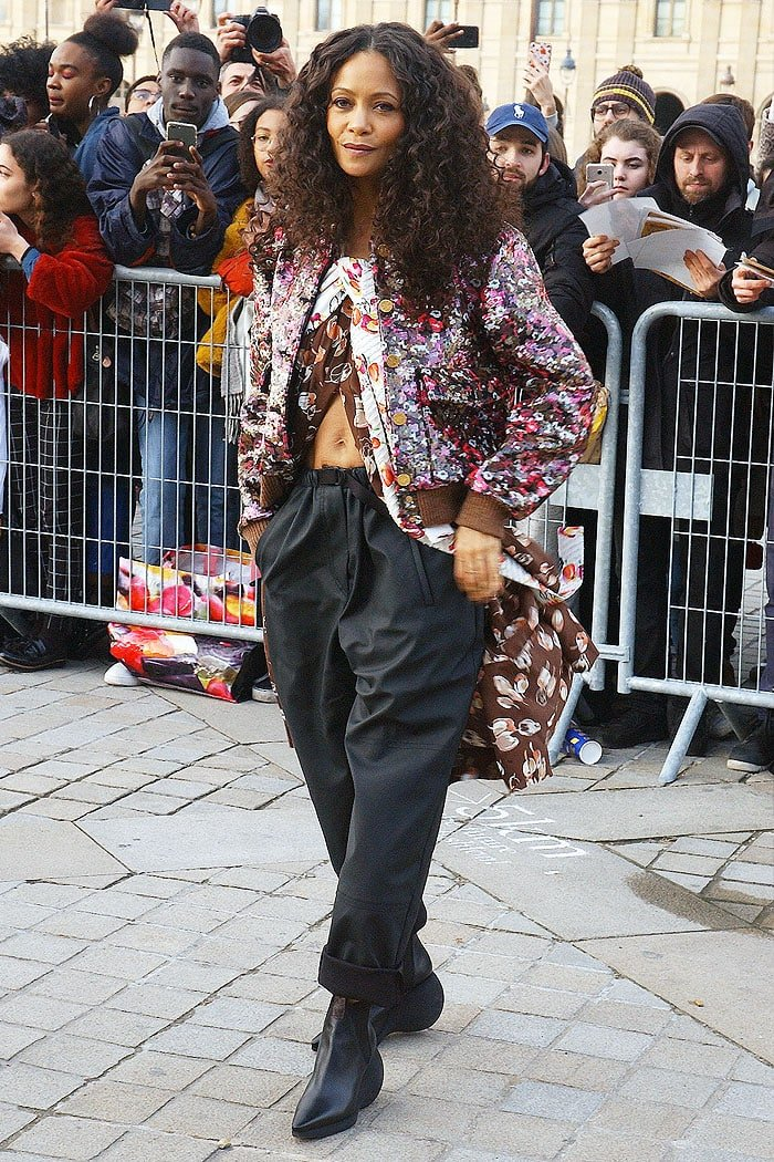 Thandie Newton rocking curly hair and a belly-baring outfit for the Louis Vuitton Fall 2019 fashion show