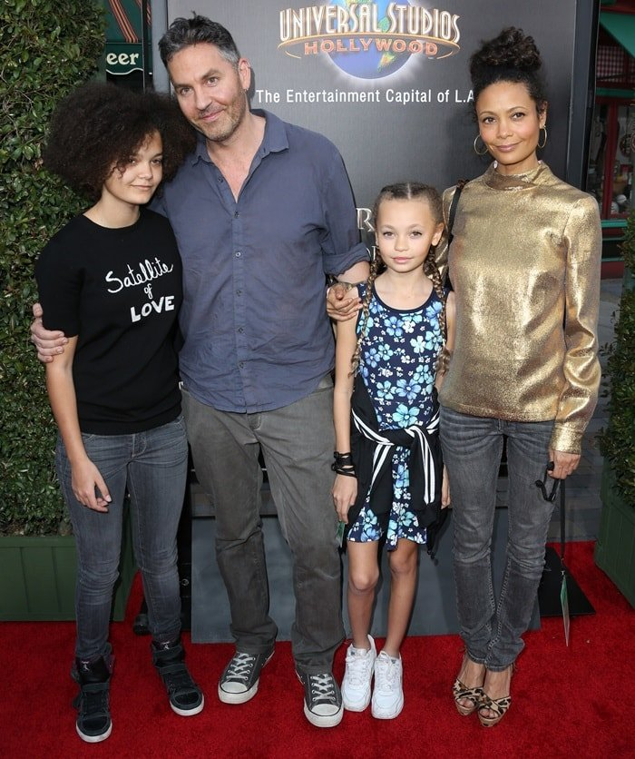 Thandie Newton posed with her husband Ol Parker and their daughters Ripley, 15, and Nico, 11, while attending the Wizarding World of Harry Potter Opening held at Universal Studios Hollywood in Universal City, California, on April 5, 2013