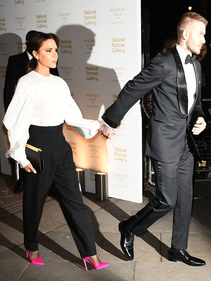 Victoria Beckham turning heads in hot, highlighter-pink heels