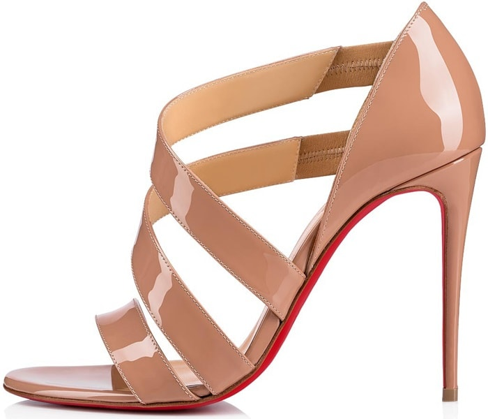 Curvy straps bridge the toe and wrap gracefully up the front of a sandal that beautifully carries you from day to evening