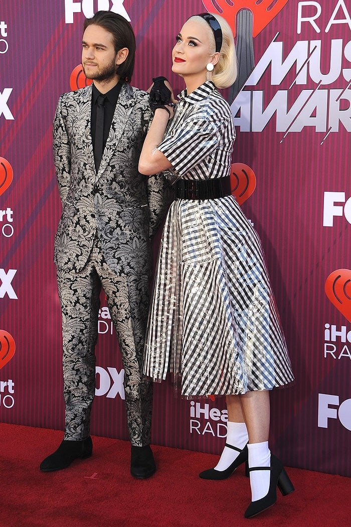 Katy Perry walking the red carpet with Zedd at the 2019 iHeartRadio Music Awards at the Microsoft Theater in Los Angeles, California, on March 14, 2019