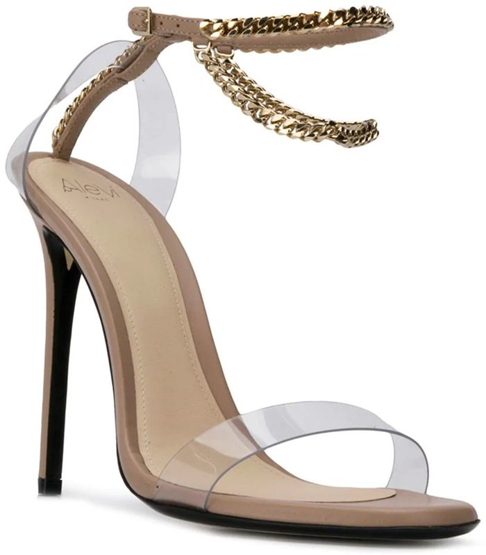 Nude leather sandals featuring an open toe, a high heel, an ankle strap, a chain link strap, and gold-tone hardware