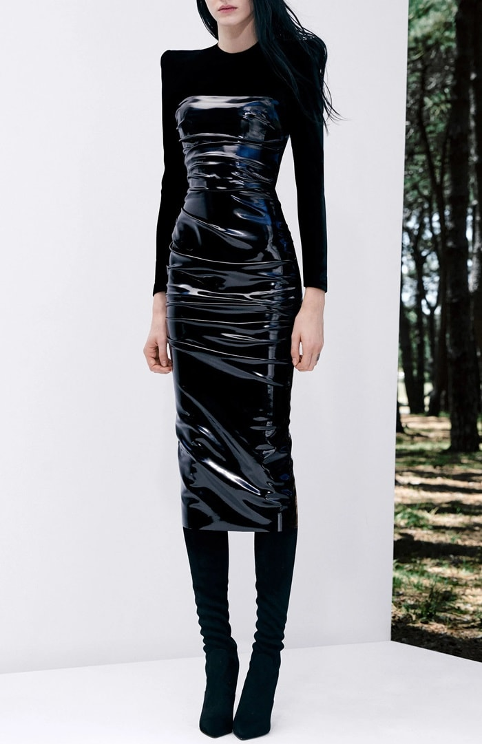 Crafted from stretch-jersey with a glossy vinyl overlay, the sexy dress hugs the body in a midi length silhouette