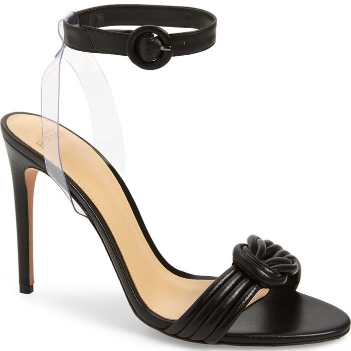 Slim leather straps are knotted at the toe of a sleek leather sandal lofted by a stiletto heel and secured with a svelte, invisibly anchored strap.