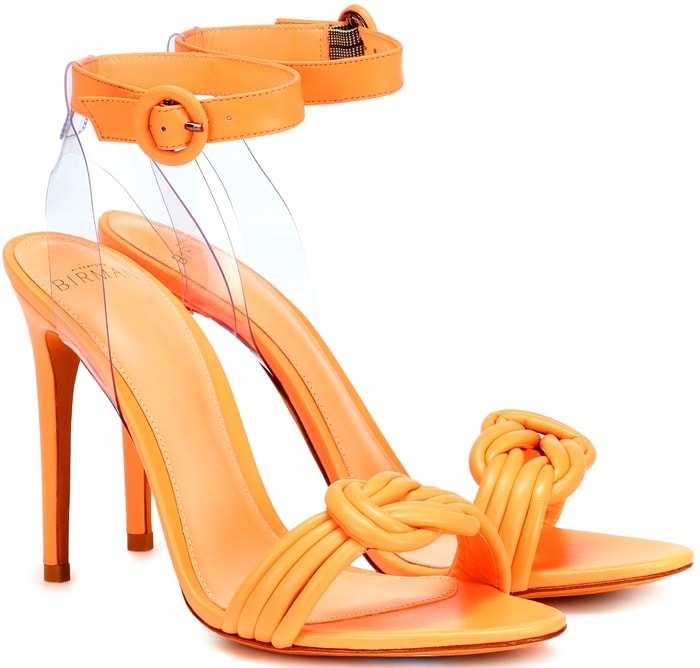 Crafted from bright orange leather, this style knots artfully across the foot and ties at the ankle, where a PVC insert adds an extra throwback touch