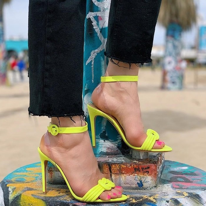 Bright neon yellow Alexandre Birman Vicky leather and clear vinyl sandal
