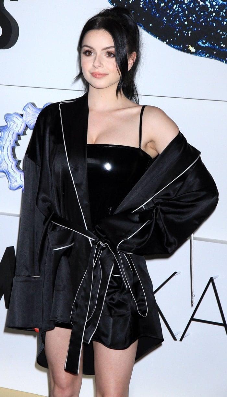 Ariel Winter's skintight black dress under an Off-White pajama shirt