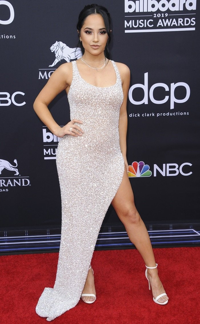 Becky G paraded her legs in a silver body-hugging Yousef Aljasmi dress