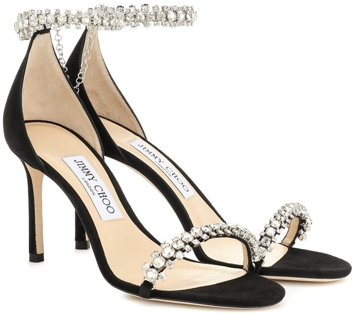 Crystal-studded straps transform these stiletto sandals into jewelry for the feet
