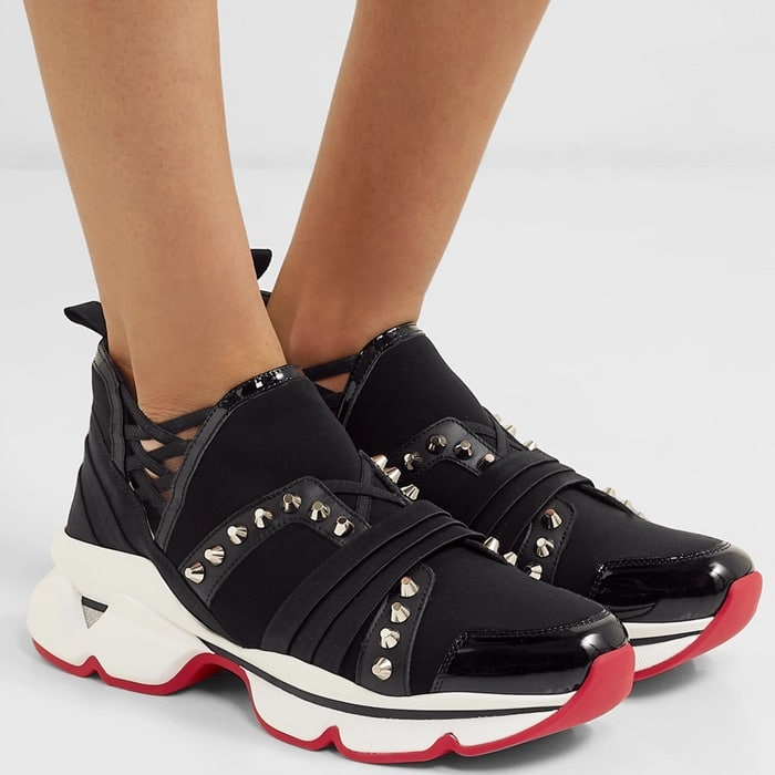 These '123 Run' sneakers have been made in Italy from neoprene and satin with strips of leather and grosgrain that resemble a laced-up corset